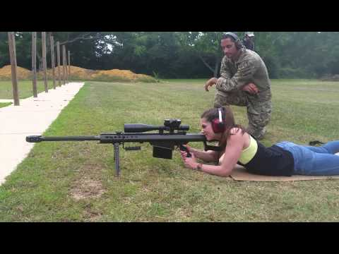 My Co worker shooting my Barrett 50cal. With night force 8-32×56 nxs scope